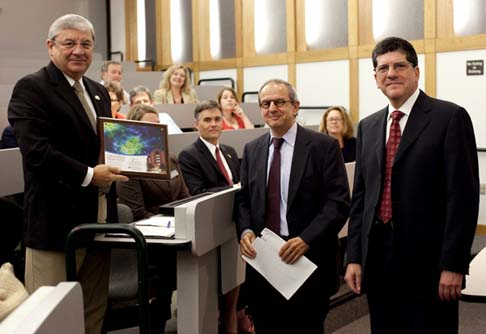 Larry Cretul, (left) speaker of the Florida House of Representatives, was recognized for his efforts in the fight against brain disease recently. Rep. Cretul is helping researchers from Florida and throughout the nation to develop treatments and cures for devastating brain tumors. Here, McKnight Brain Institute Executive Director Dennis Steindler, Ph.D., (center) and William Friedman, M.D., chair of the department of neurosurgery, thank Cretul for his support of the Florida Center for Brain Tumor Research at UF's McKnight Brain Institute. Photo by Sarah Kiewel / University of Florida