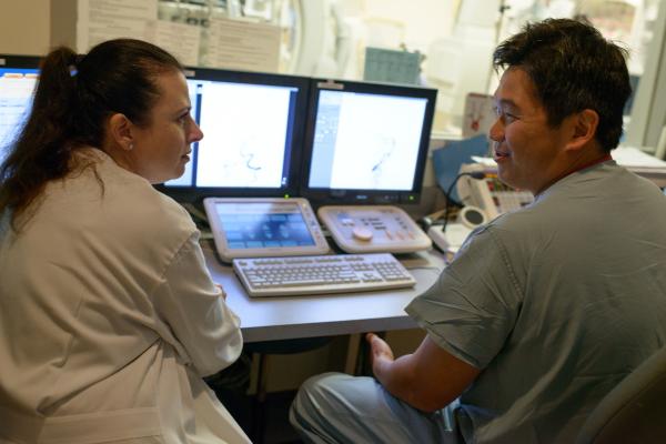 Dr. Khanna and Dr. Hoh, neurologists and neurosurgeon, Departments of Neurology and Neurosurgery