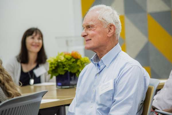 Harris Rosen smiles at a table