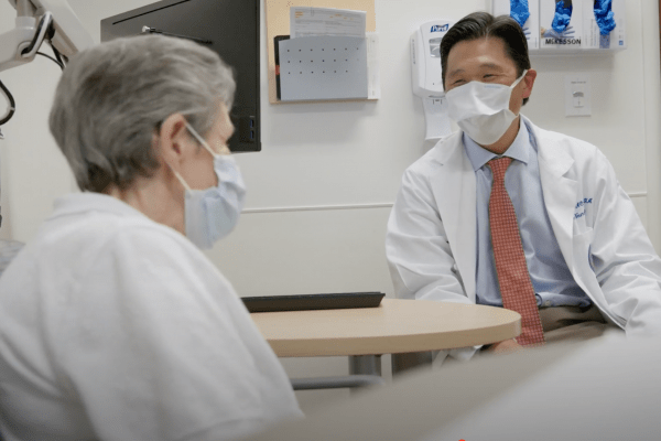 Doctor hoh talking with a patient
