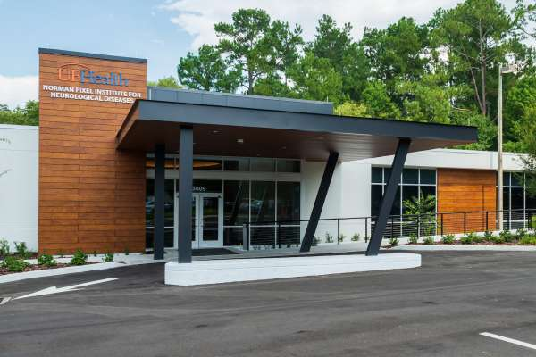 photo of the front of the Fixel building. it looks new and there is an space to pull your car up to the front of the building