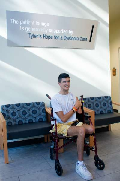 Tyler Staab in the patient lounge dedicated to Tyler's Hope for a Dystonia Cure.