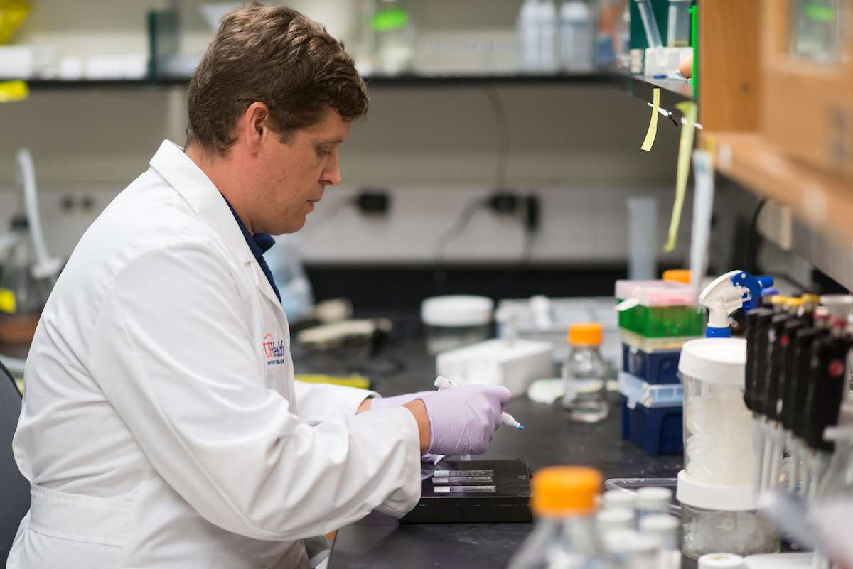 Dr. Jeremy McIntyre conducting research with colleagues in the lab