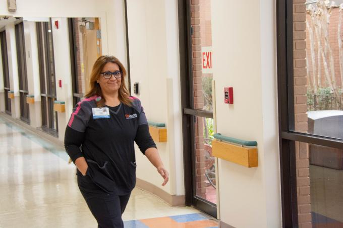 Nurse walking down a hallway