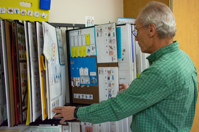 Nurse going flipping through diagrams used for learning